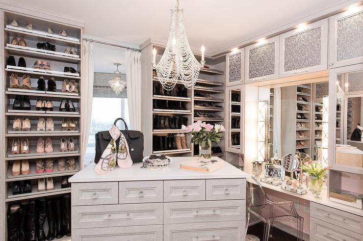 light gray pink walk in closet built in shoe shelves